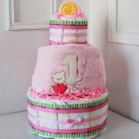 Торт из памперсов на заказ для новорожденной девочки